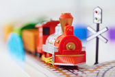 Toy railway - red engine closeup — Stock Photo