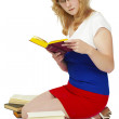 Stock Photo: Young womreading book