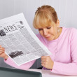 Womreading newspaper - bad news — Stock Photo #5090409