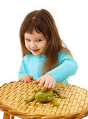 Girl cautiously stroking a toy lizard — Stock Photo