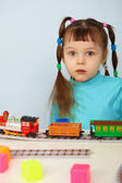 Amazed child and toy railway — Stock Photo