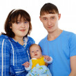 Young family - mom, dad and baby on white — Stock Photo