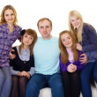 Royalty-Free Stock Photo: Big family on couch - four women and one man