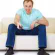Male switch TV channels in despair — Stock Photo