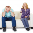 Nervous husband and wife sitting on couch watching TV — Stock Photo