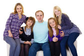 Big family on couch - four women and one man — Stock Photo