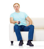 Indifferent everyman looks boring advertising on TV — Stock Photo