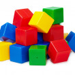 Pile of colored toy blocks on white — Stock Photo