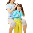 Mom makes daughter hairstyle — Stock Photo