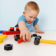 Royalty-Free Stock Photo: Child playing with a toy plastic constructor