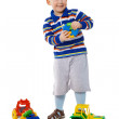 Child playing with toys on white background - Stock Photo