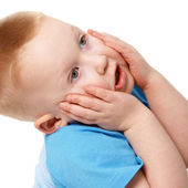 Little boy emotionally grabbed hold of face — Stock Photo