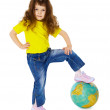 Little girl put her foot on geographic globe — Stock Photo