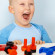 Jubilant children with toys — Stock Photo