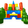 Toy colored castle and plastic trees — Stock Photo
