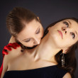 Two girls portrayed vampire and the sacrifice — Stock Photo