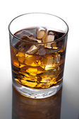 Glass of scotch whiskey and ice — Stock Photo