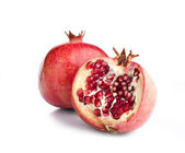 Juicy opened pomegranate — Stock Photo