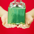 Gift in hands — Stock Photo