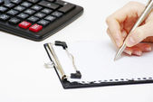 Pen and calculator — Stock Photo
