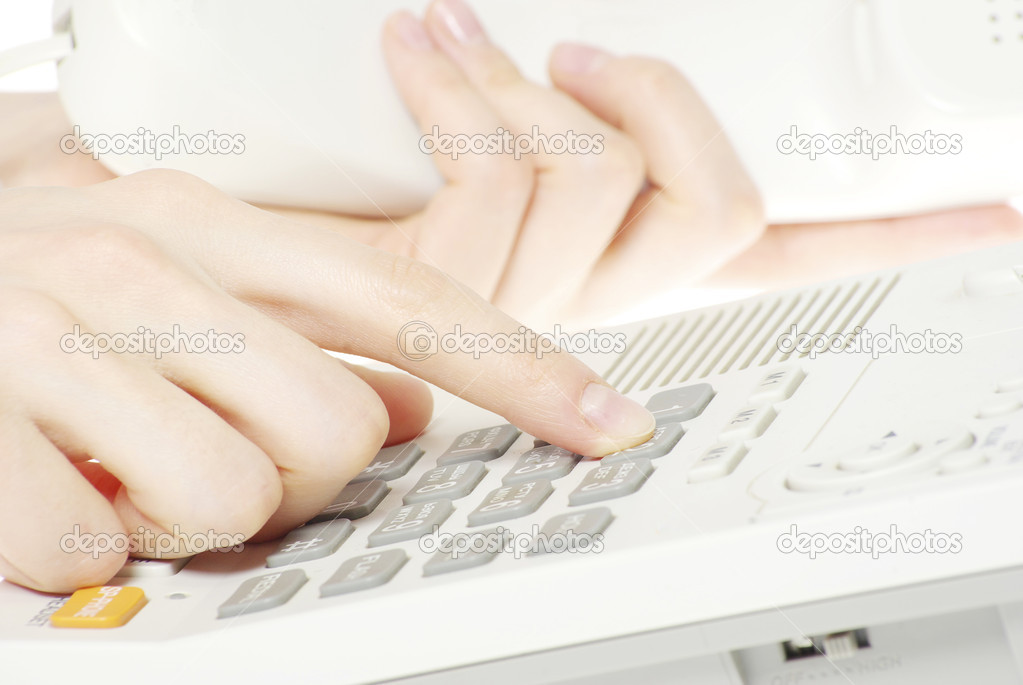 Finger with  white telephone keypad — Stock Photo #4905104