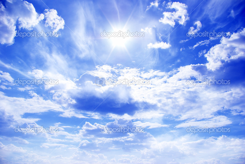 Sun in a blue cloudy sky — Stock Photo #5141774