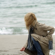 Woman on sea shore — Stock Photo