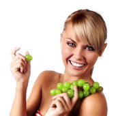 Beautiful young woman with bunch of grape. — Stock Photo