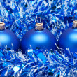 Blue christmas balls with tinsel — Stock Photo #4090273