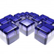 Abstract composition of blue glass cubes over white background — Stock Photo #4316887