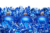 Blue christmas balls with tinsel isolated over white background — Stock Photo