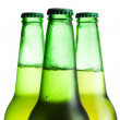 Three green beer bottles isolated over white — Stock Photo #4524543