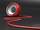 Czerwony głośnik z kabla na szarym tle — Zdjęcie stockowe