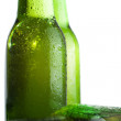 Three green beer bottles with ice over white — Stock Photo #5246100
