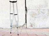 Ferroconcrete wall and and crutches — Stock Photo