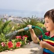 Boy watering flowers — Stock Photo