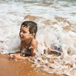 Child playing in the sea — Stock Photo