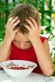 The little sad boy eats soup — Stock Photo