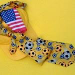 Yellow Baseball Cap, Necktie and US Flag — Stock Photo #4065550