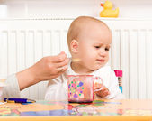 Feeding procedure of a little baby — Stock Photo