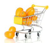Tangerine in the shopping cart — Stock Photo