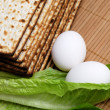 Matzot, eggs and lettuce - Stock Photo