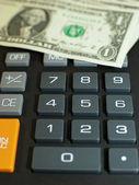 Miniräknare och momey — Stockfoto