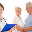 Woman doctor and an couple — Stock Photo