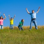 Happy hopping family — Stock Photo