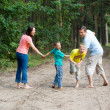 Family of four walking — Stock Photo