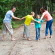 Family of four walking — Stock Photo #5199954