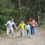 Family of four walking — Stock Photo