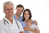 Doctor and family with a newborn — Stock Photo