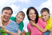 Happy parents with their children — Stock Photo